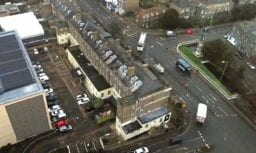 aerial drone survey of cambridge hotel and street
